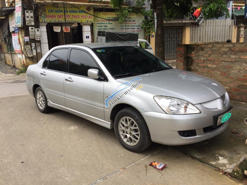 Cần bán lại xe Mitsubishi Gala 1.6 2004, màu bạc