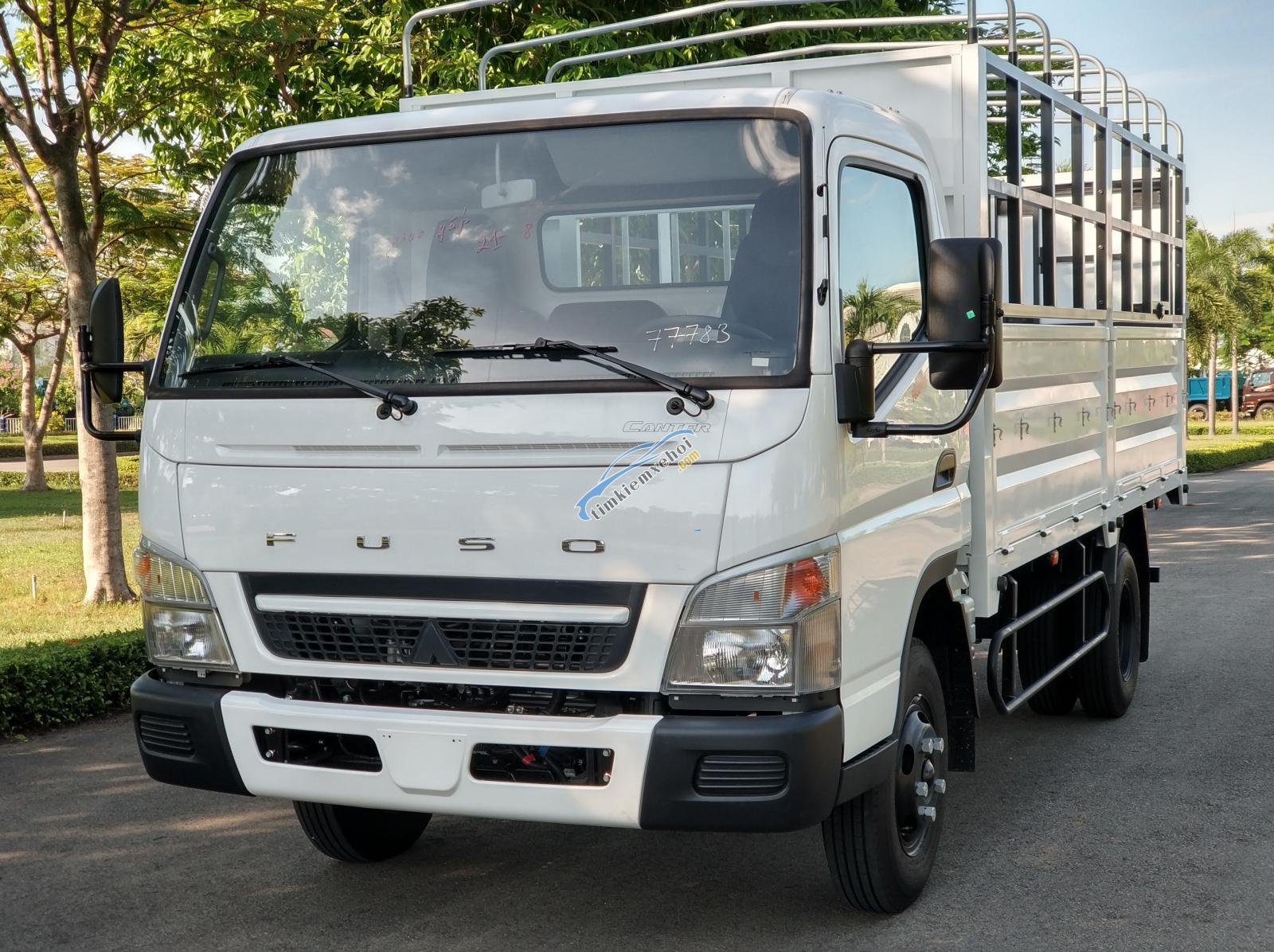Bán xe tải Misubishi Fuso 6.5 thùng mui bạt - 3,4 tấn trả góp 80%