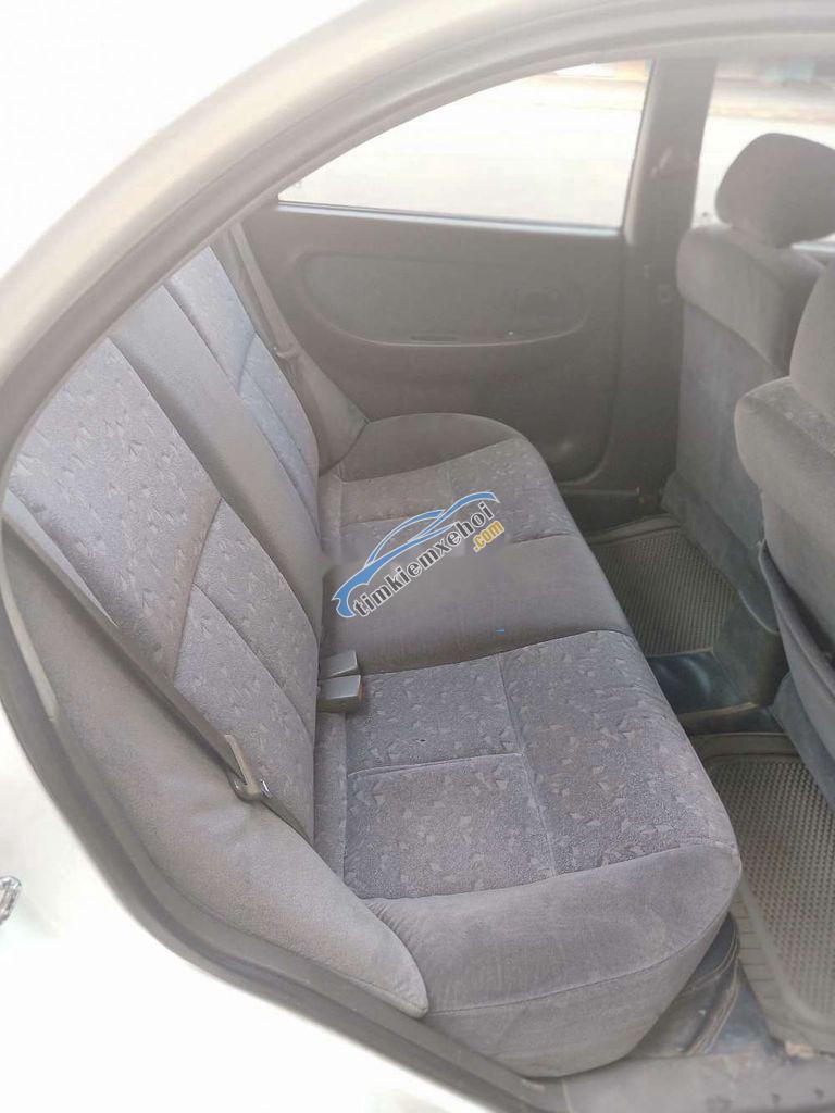 Cần bán xe Kia Spectra đời 2003, màu trắng, nhập khẩu