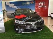 Cần bán xe Toyota Corolla Altis 1.8E CVT sản xuất 2018, giá cực tốt, đủ màu giao ngay, hỗ trợ trả góp 85% giá 677 triệu tại Hà Nội