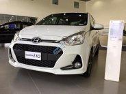 Bán xe Hyundai Grand i10 1.2AT sản xuất 2018, màu trắng giá 405 triệu tại Tp.HCM