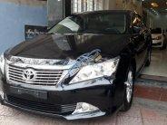 Bán Toyota Camry 2.0E sản xuất 2014, màu đen như mới giá 829 triệu tại Hà Nội