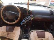 Cần bán xe Kia Spectra sản xuất năm 2004, màu đen giá 105 triệu tại Bắc Giang