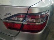 Cần bán Toyota Camry 2.0E năm 2015, màu bạc giá 890 triệu tại Tp.HCM