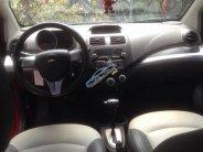 Bán Chevrolet Spark 2015, màu đỏ  giá 262 triệu tại Tp.HCM
