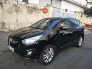 Bán xe Hyundai Tucson 2.0 AT 4WD đời 2010, màu đen, nhập khẩu  giá 525 triệu tại Tp.HCM
