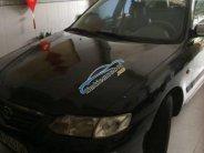 Bán Mazda 626 2.0 MT đời 2003, màu đen giá 166 triệu tại Bình Định