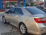 Bán Toyota Camry năm 2013, màu vàng giá 870 triệu tại Tp.HCM