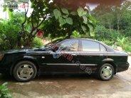 Bán Daewoo Magnus đời 2004, màu đen số tự động giá 175 triệu tại Hà Giang