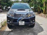Cần bán lại xe Toyota Hilux 3.0G 4x4MT năm 2016, màu xám  giá 785 triệu tại Đồng Tháp