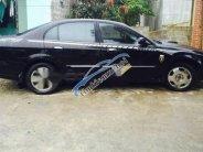 Cần bán xe Daewoo Magnus năm 2004, màu đen số tự động giá 150 triệu tại Hà Giang