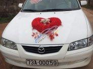 Bán ô tô Mazda 626 sản xuất 2001, màu trắng, nhập khẩu nguyên chiếc giá 170 triệu tại Quảng Bình