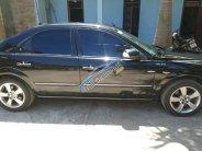 Bán Ford Mondeo SX 2004, màu đen giá cạnh tranh giá 265 triệu tại Sơn La