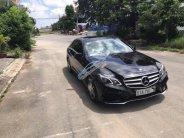 Cần bán Mercedes E400 AMG đời 2014, màu đen giá 1 tỷ 689 tr tại Tp.HCM