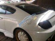 Bán Hyundai Tuscani đời 2005, màu trắng chính chủ giá 360 triệu tại Tp.HCM