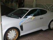 Bán xe Hyundai Tuscani 2.0 đời 2005, màu trắng, nhập khẩu giá 360 triệu tại Tp.HCM