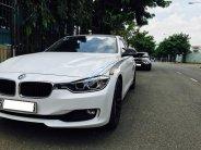 BMW 320i ĐK 2014, xe nhập khẩu, nâng cấp full options, có đổi xe giá 1 tỷ 100 tr tại Tp.HCM