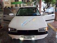 Cần bán lại xe Mazda 323 đời 1997, màu trắng, nhập khẩu nguyên chiếc chính chủ, 85 triệu giá 85 triệu tại Thanh Hóa