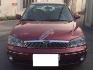 Cần bán Ford Laser đời 2002, màu đỏ, nhập khẩu nguyên chiếc số sàn giá 225 triệu tại Bình Dương