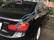 Bán xe BMW 3 Series 320i đời 2014, màu đen giá 1 tỷ 100 tr tại Tp.HCM