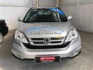Bán xe Honda CR V 2.4 AT đời 2010, màu bạc, giá tốt giá 650 triệu tại Tp.HCM