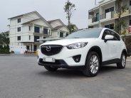 Bán xe Mazda CX 5 2.0 AT AWD đời 2014, màu trắng, ít sử dụng giá 686 triệu tại Hà Nội