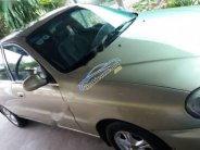Cần bán Daewoo Lanos SX 2002, màu vàng cát giá 112 triệu tại Bình Dương
