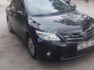 Chính chủ bán xe Toyota Corolla altis 1.8G MT đời 2011, màu đen giá 488 triệu tại Hà Nội