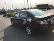 Bán xe Toyota Corolla Altis 1.8G AT sản xuất 2012, màu đen giá 600 triệu tại Hà Nội
