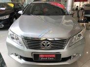 Cần bán xe Toyota Camry 2.0E năm sản xuất 2014, màu bạc, hỗ trợ ngân hàng giá 840 triệu tại Tp.HCM