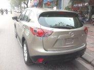 Bán Mazda CX 5 2.0AT 2013, màu vàng giá 665 triệu tại Hà Nội