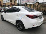 Cần bán Mazda 2 All New Full Option số tự động, đời 2015, mầu trắng đẹp nguyên bản giá 485 triệu tại Hà Nội