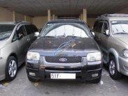 Cần bán xe Ford Escape Limited 3.0 năm 2003, màu đen số tự động giá 210 triệu tại Tp.HCM