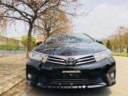 Bán Toyota Corolla Altis 1.8AT năm sản xuất 2015, màu đen, 695tr giá 695 triệu tại Hà Nội