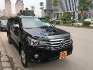 Bán Toyota Hilux G 4x4 AT năm 2016, màu đen  giá 825 triệu tại Hà Nội