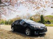 Cần bán lại xe Toyota Corolla altis 1.8AT đời 2015 giá 695 triệu tại Hà Nội
