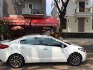 Bán Kia K3 2015, màu trắng giá 580 triệu tại Hà Nội