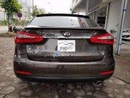 Cần bán lại xe Kia K3 1.6AT đời 2015, màu nâu, giá tốt giá 575 triệu tại Hà Nội