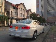 Bán xe BMW 3 Series 320i sản xuất 2015, màu trắng, nhập khẩu giá 1 tỷ 200 tr tại Hà Nội