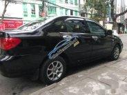 Cần bán lại xe Toyota Corolla sản xuất 2003, màu đen giá 220 triệu tại Đà Nẵng