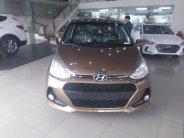 Bán Hyundai Grand i10 1.2L AT sản xuất 2018, màu vàng cát, xe giao ngay giá tốt giá 394 triệu tại Hà Nội