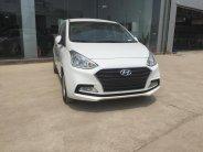 Cần bán xe Hyundai Grand i10 1.2L MT đời 2018, màu trắng, giá tốt giao xe ngay giá 382 triệu tại Hà Nội