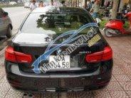 Bán ô tô BMW 3 Series AT sản xuất 2015, màu đen giá 1 tỷ 180 tr tại Hà Nội