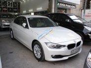 Cần bán xe BMW 3 Series 320i đời 2014, màu trắng, xe nhập số tự động giá 1 tỷ 70 tr tại Tp.HCM
