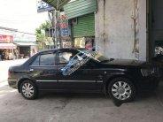 Cần bán lại xe Ford Laser 2005, màu đen, giá tốt giá 275 triệu tại Bình Dương