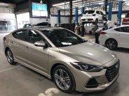 Bán Hyundai Elantra 1.6TURBO sản xuất 2018, màu vàng giá 734 triệu tại Tp.HCM