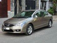 Bán xe Honda Civic 2.0AT năm 2009, màu vàng cát giá 490 triệu tại Tp.HCM