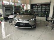 Cần bán xe Toyota Vios E đời 2018, màu vàng giá 513 triệu tại Hà Nội