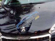 Cần bán gấp Peugeot 208 1.6 AT đời 2016, màu đen xe gia đình  giá 630 triệu tại Hà Nội