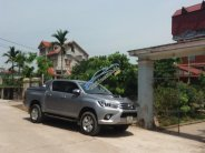 Bán Toyota Hilux 3.0G 4x4 AT năm sản xuất 2015, màu bạc, nhập khẩu nguyên chiếc  giá 670 triệu tại Hà Nội